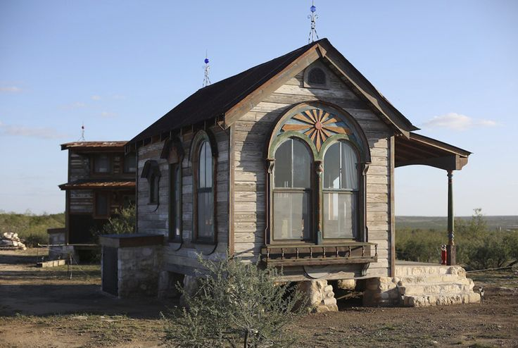 Made from 95% salvaged materials, the Arched Zebu is a tiny prairie house from Texas Tiny Houses. Measuring 12- by 18-feet, the house is built from materials that are close to 200 years old. Featuring beautiful arched windows, the cottage includes a lofted sleep area, kitchen, and shabby chic details. Look inside the Arched Zebu.
