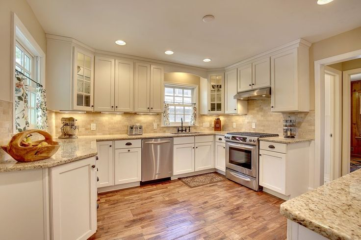 Traditional Kitchen with Giallo Ornamental Granite, MS International, Stone Tile, Hardwood floors, U-shaped, Flush