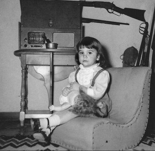 "Linda Ronstadt -- ""Sitting in front of my best friend, the radio."" -- 1949 -- Photo: Gilbert Ronstadt"