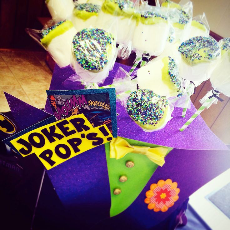Joker pop's! Hand made chocolate covered marshmallows with sprinkles. I made the box look like The Joker's suit for the kids comic book birthday party.