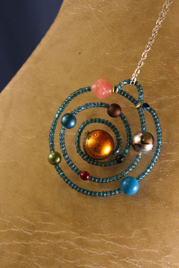 Solar system necklace.. so cute for us science teachers :)