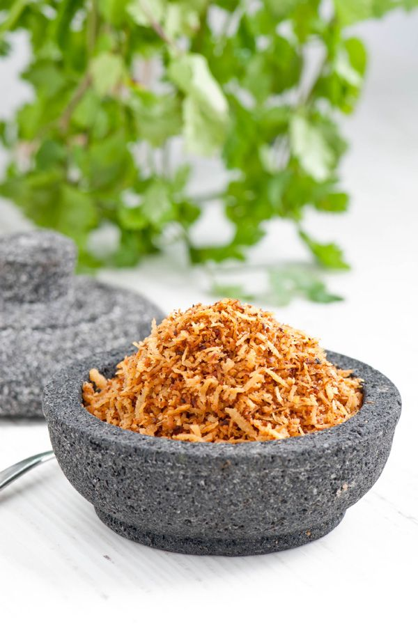 Serundeng - Fresh grated coconut flavoured with aromatic herbs and spices. A popular condiment in Singapore, Malaysia and Indonesia.