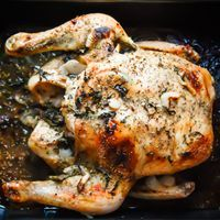 moist whole baked chicken infused with the flavors of fresh basil, garlic and onion http://mamadweeb.com/2013/09/roasted-garlic-basil-chicken/ 1 to 2 cups water, 1 small sweet or yellow onion, slivered thinly, 4 to 6 cloves of fresh chopped garlic, or 1 to 2 tablespoons minced garlic, 5 to 10 fresh basil leaves, rough chopped, 1 tablespoon olive oil, 1 teasp salt, ½ teasp freshly ground black pepper, ½ teasp onion powder, ½ teasp garlic powder, 1 teasp dried basil leaves 1.5 hrs at 375°