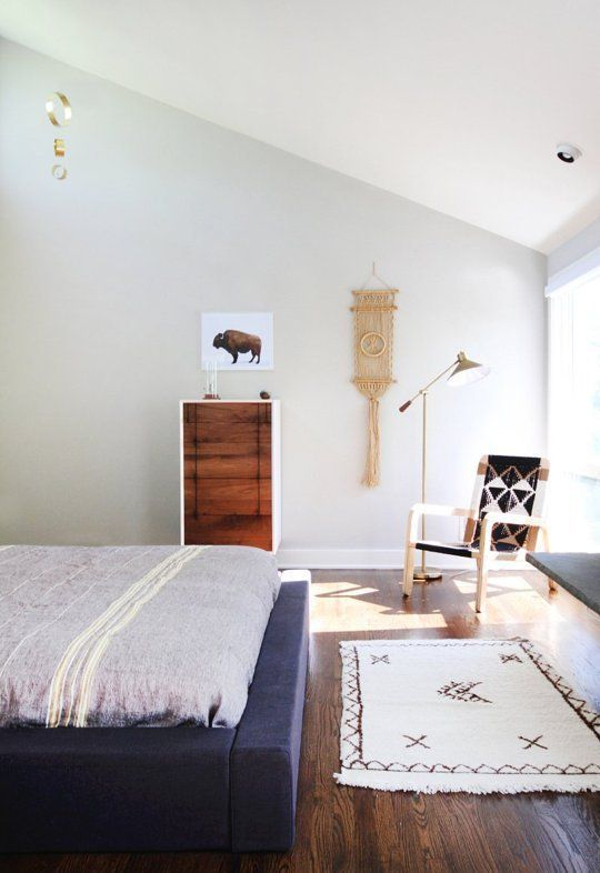Love the warm ness of this bed platform. Curious about storage under there though!