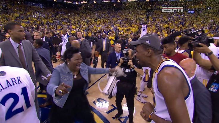 Kevin Durant comes together with LeBron James and several Cavaliers, then embraces his mother and Steph Curry.