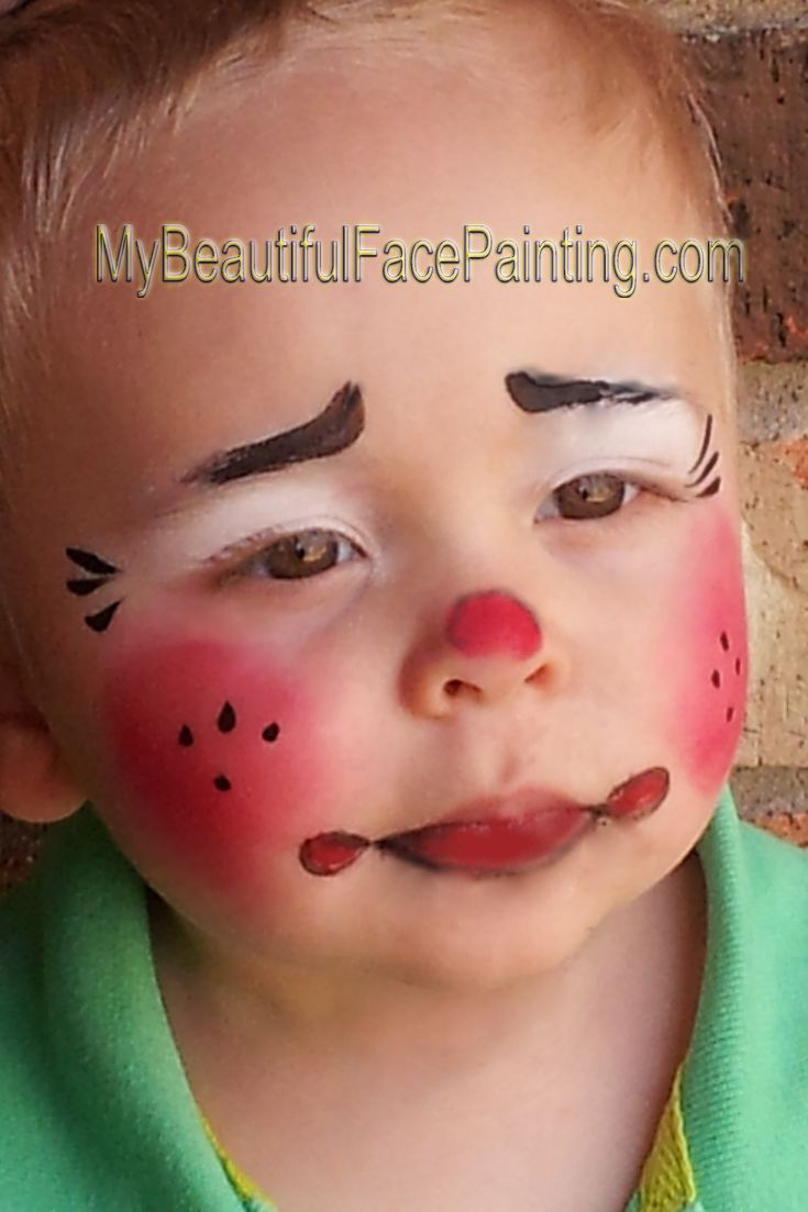 Baby clown face paint. Starblend powders for cheeks and nose, and white for eyes. DFX black and Tag red.