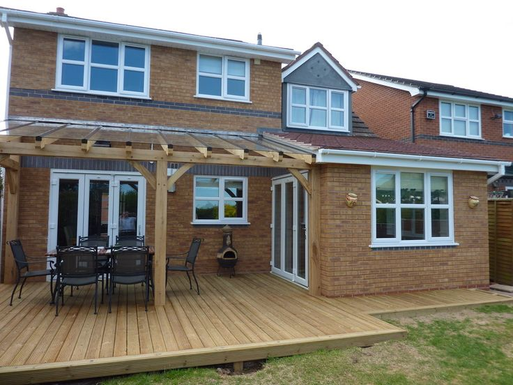 Extension with part covered decking finished with Oak timber & toughened glass roof. Project completed in 6 weeks. 2011