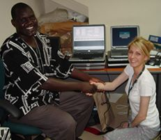 Richard Omore, the GEMS Kenya study coordinator at KEMRI in Kisumu, Kenya, and Ciara O'Reilly, CDC Atlanta epidemiologist in the Waterborne Diseases Prevention Branch, celebrate getting a search engine for randomization of controls in the GEMS case-control study up and running and loaded on laptops for each of the GEMS clinics. The computers were donated by the CDC Atlanta excess old supplies unit.