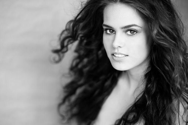 Black and white windy hair brunette model headshot intense look Ksenia Belova Photography Melbourne