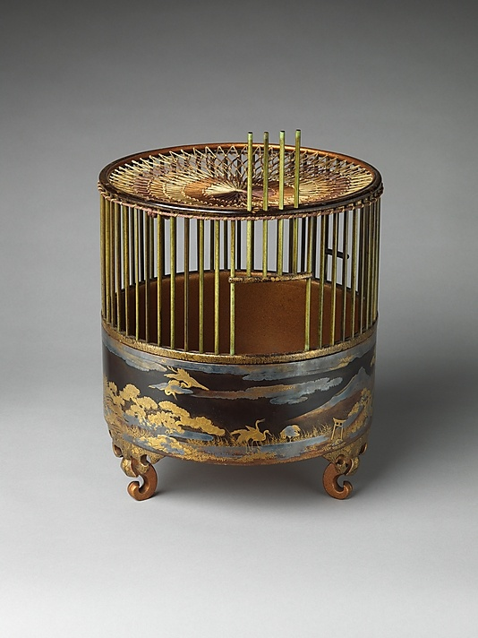 """Japanese Bird Cage - 18th C. /  Black lacquer ground with gold and silver maki-e, dyed wood, and silk netting - The cranes, wheels, and flowing poem scripts decorating this birdcage refer to both Wakanoura, an inlet on the Kii Peninsula revered as the """"bay of poetry,"""" and to several famous compositions that celebrate this scenic place."""