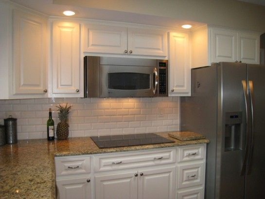White Subway Tile With New Venetian Gold Granite Countertop