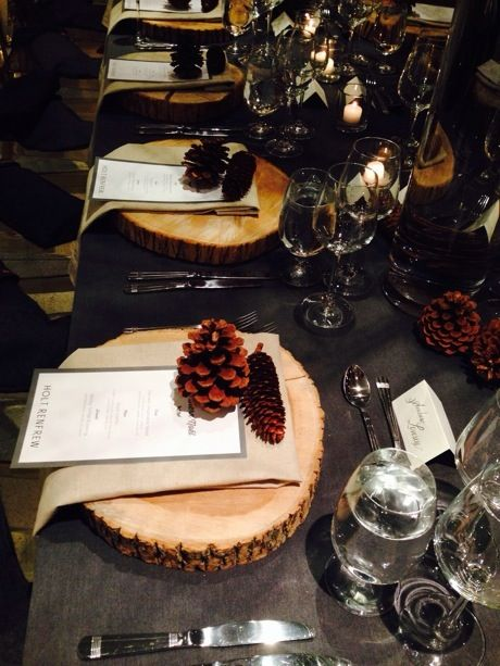 Rustic table settings with tree trunk plate chargers. Fun with chainsaws anyone?