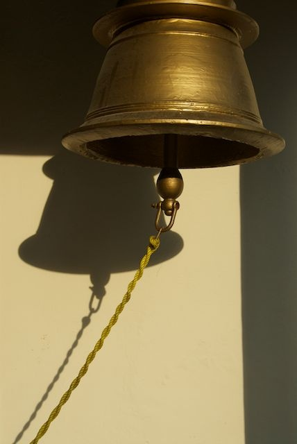 Looking for light and finding a bell and its shadow.