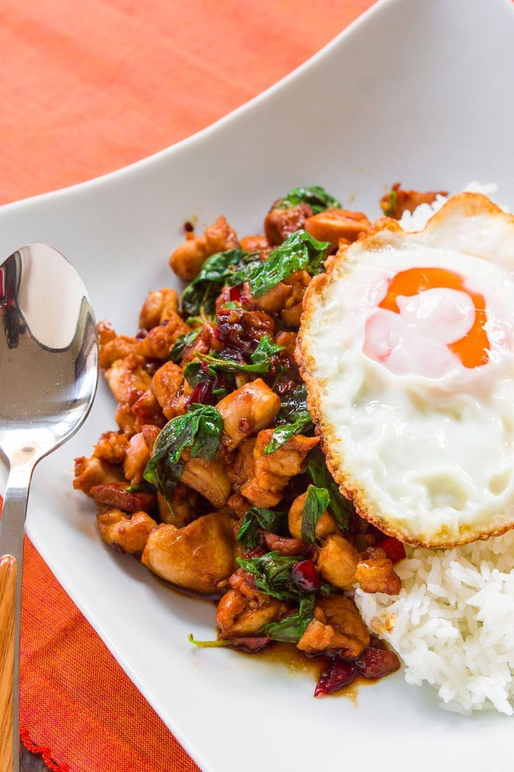 This 10 minute Thai Basil Chicken (Pad Krapow Gai) is easy, satisfying and delicious. Spicy and garlicky with a savory sweet glaze and fragrant holy basil, it makes for a delicious meal with some jasmine rice and a crisp fried egg. #thai #chicken #stirfry
