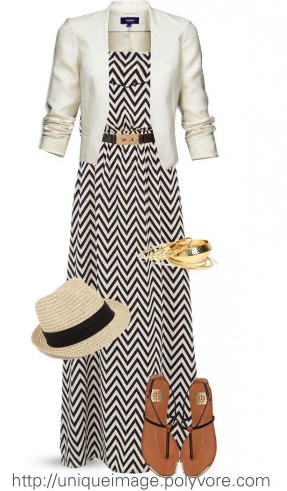 White blazer, black and white zig-zag striped maxi dress, fedora, brown gladiator sandals.
