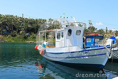 White fishing boat moored in the estuary of the small village Sissi. Crete, Greece