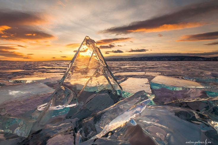Winter sunset on Lake Baikal known for its unusual forms of ice cover