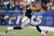 Julian Edelman #11 of the New England Patriots catches a pass during the second quarter against the New York Jets at Gillette Stadium on October 16, 2014 in Foxboro, Massachusetts.