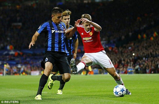 Bruges' Oscar Duarte (left) struggles to keep Adnan Januzaj during his side's defeat at Old Trafford