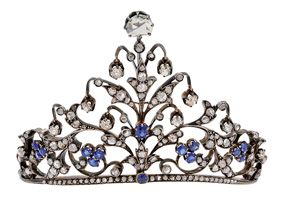 An Antique Sapphire and Diamond Tiara of triangular peaked design extending from a narrow band, the floral and foliate motifs with rose-cut diamond leaves amid sapphire florets and buds, further embellished by suspended old mine-cut diamond drops, the apex enhanced by a larger rose-cut diamond, mounted in silver and 18k gold, French assay marks, with fitted box, late 19th century