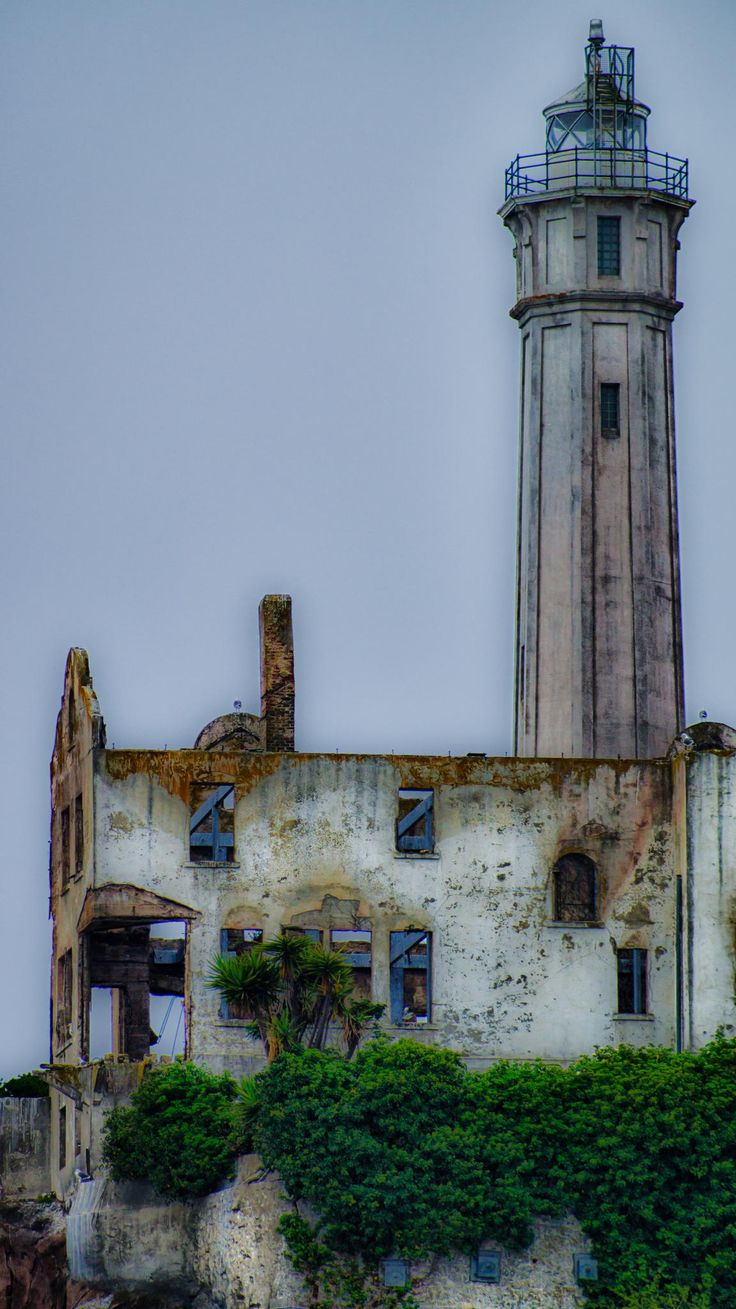 """Light house and Wardens house on Alcatraz Island. Alcatraz, aka """"The Rock"""", was first established as a military fort in the 1850s by the US Army."""