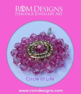 Rom Designs Cancer Awareness Circle of Life pendant. The centre Rose crystal is the Swarovski birthstone that we use for the month of October. The COL in this photo is from the Cancer Awareness Collection so it has the Cancer Pink on the outer and inner circle with the Rose birthstone in the centre circle. The pendant is reversible with yellow gold tone on one side and silver on the other. The bail is made large enough to allow for swapping of chains…