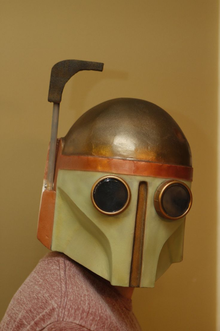 Steampunk Boba Fett helmet made from cardboard, fiberglassed for stength, and painted.
