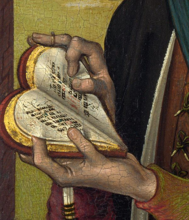 """heart-shaped prayer book """"book of hours"""". This is a well known real book that has been included in an illumination."""