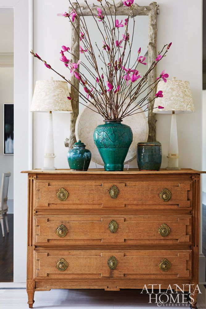 entry chest furniture. the entry foyer mixes rustic with formal touches thanks to a textured mirror and antique chest furniture d