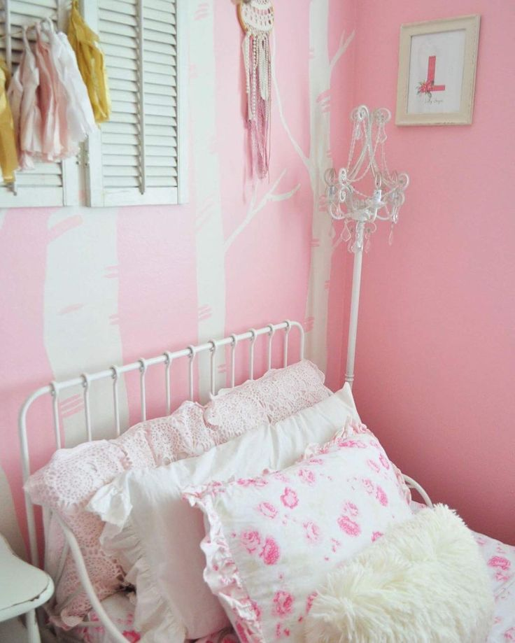 Toddler Girls Room. Trees painted on Wall. Floral Bedding. Shutter Decorations. Chandelier. Floral.