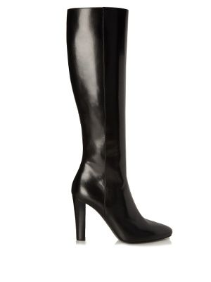 Statement yet so versatile, Saint Laurent's smooth black leather Lily boots will become a linchpin of your trans-seasonal portfolio. They shaped to hit just beneath the knee, and have a pointed toe and high block heel to ensure a streamlined finish.