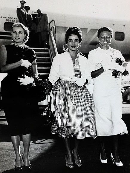 Grace Kelly & Liz Taylor & Laraine Day-Liz looks all-American in a checked dress and little white gloves as she arrives into Los Angeles in 1950.