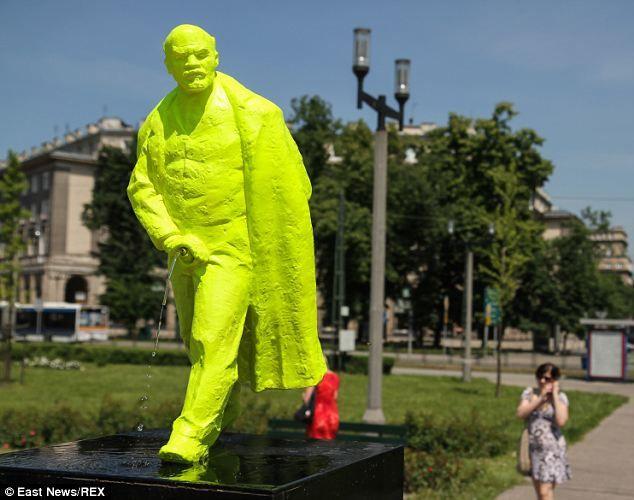 Taking the p***? This fluorescent green statue of Lenin taking a leak has been erected as part of the Grolsch ArtBoom Festival in Nowa Huta, a suburb of Krakow, the capital of Poland