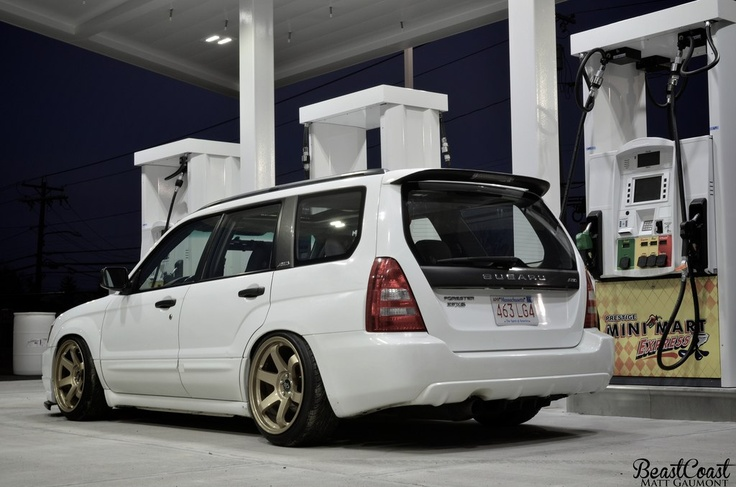 Subaru Forester. I am a complete sucker for white with gold rims.