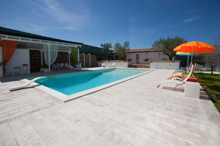 stylish stamped #concrete poolside - wood effect http://www.idealwork.com/Stamped-concrete-Features-and-benefits.html