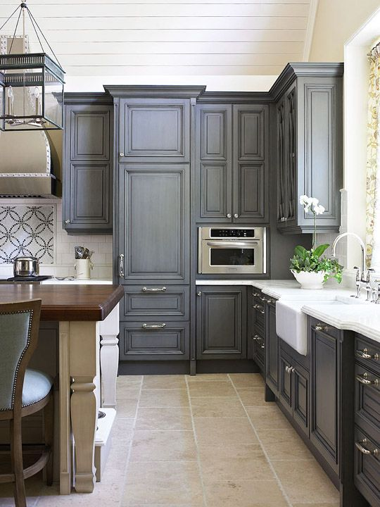 Diggin' the charcoal cabinets and accent island in this lovely kitchen--AND don't forget the farmhouse sink!