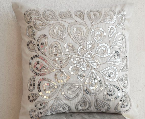 Ivory white throw pillows with silver sequins