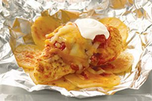 Tender potatoes topped with seasoned chicken, cheese and salsa.  That's right - our potato and chicken dinner is cooked all together in a foil-pack, saving on prep and clean-up!