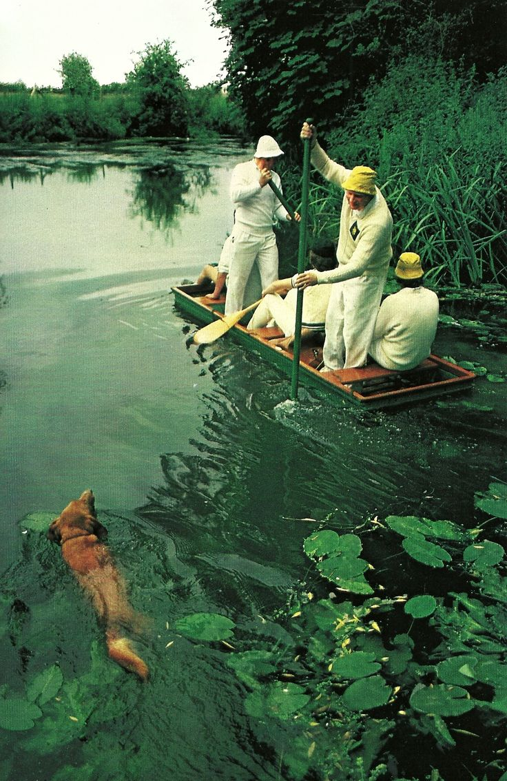 Cricklade Cricket Club members punt to a Sunday match escorted by their loyal mascot Toby National Geographic | June 1983