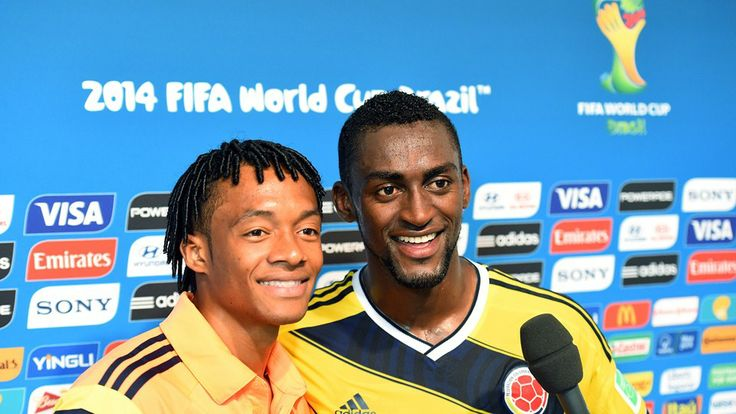 Juan Guillermo Cuadrado (L) and Jackson Martinez of Colombia are interviewed
