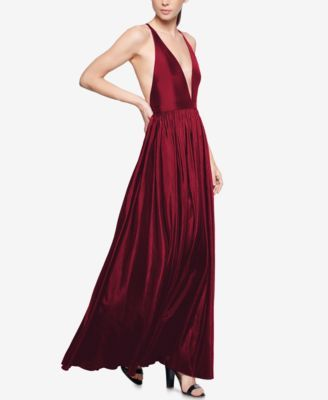 This stunning Old Hollywood style gown from Fame and Partners features a plunging neckline with mesh panel inset, an open crisscross back and a romantic, voluminous maxi skirt. | Nylon taffeta; trim: