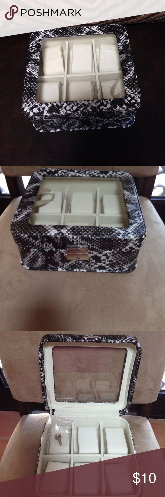 Watch storage box Box with key for storing your watches in snake-like material. Can store 6 watches. Black/white color Other