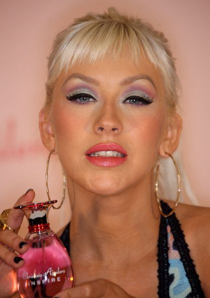 """Christina Aguilera Photos - Recording artist Christina Aguilera poses for photographers during an autograph session and the launch of her new perfume """"Inspire"""" at Macy's Glendale Galleria on December 5, 2008 in Glendale, California.  (Photo by Frederick M. Brown/Getty Images) * Local Caption * Christina Aguilera - Launch Of Christina Aguilera's """"Inspire"""""""