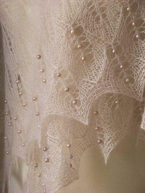 Beautiful beige sand colored lace knitted triangular shawl. It has knitted into it 162 real freshwater pearls, which makes the shawl extra special. The pearls are pinkish beige of color with that perfect pearly shine.