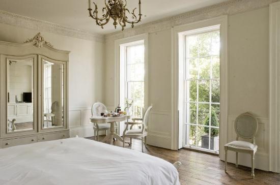 pretty room with wonderful windows & armoire