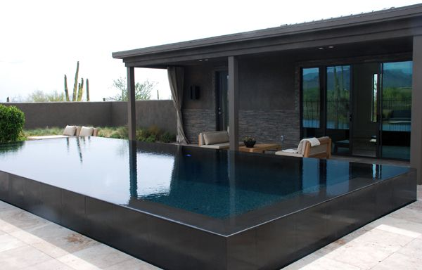 Model Home Pool & Casita Raised black tiled interior pool with infinity edge to all sides creates a mirror effect on the pool surface. Pinned onto Pool Design by Darin Bradbury.