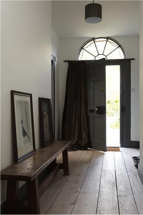 A hall with walls in Strong White Estate Emulsion and woodwork in Down Pipe Estate Eggshell. farrow and ball