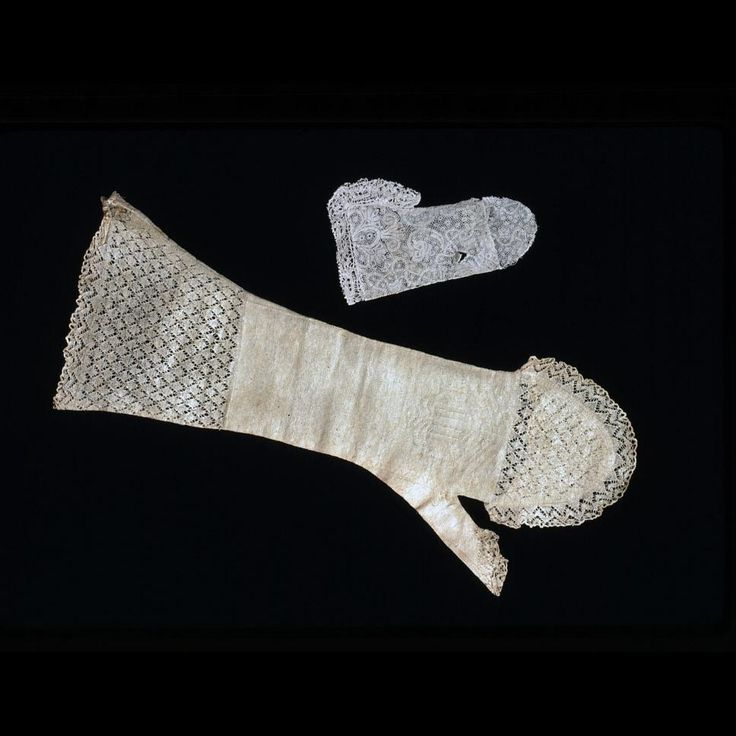 """Woman's mitt, knitted cotton Ca. 1700 Origin: Europe, probably Holland or England OL: 14""""; OW (gauntlet when flat): 6"""" Knitted cotton Gift of Mrs. Cora Ginsburg.  Colonial Williamsburg"""