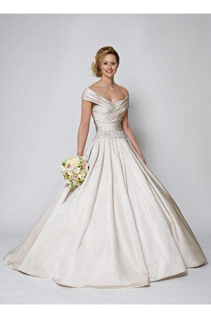 We asked thousands of men to vote on what their idea of the perfect wedding dress is and asked top bridal designer Ian Stuart to bring it to life, as seen on BridesMagazine.co.uk (BridesMagazine.co.uk)
