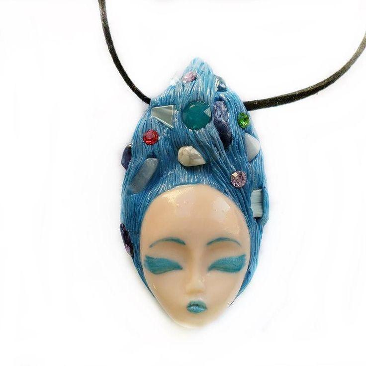 A goddess with lovely blue hair adorned with natural semi-precious stones such as: chalcedony sodalite howlit transparent quartz and crystals.  #instajewelry #jewelrygram #jewelrydesign #jewelrydesigner #jewelryaddict #customjewelry #fashionjewelry  #artist #artisan #jewelry #etsyjewelry #handmadejewelry #jewelryforsale s #etsyshop #clayjewelry #artisanjewelry #handmade #crystals  #semipreciousstones #semiprecious #golden #pagan #crystaljewelry #crafter #art #artjewelry #goddess #wiccan…